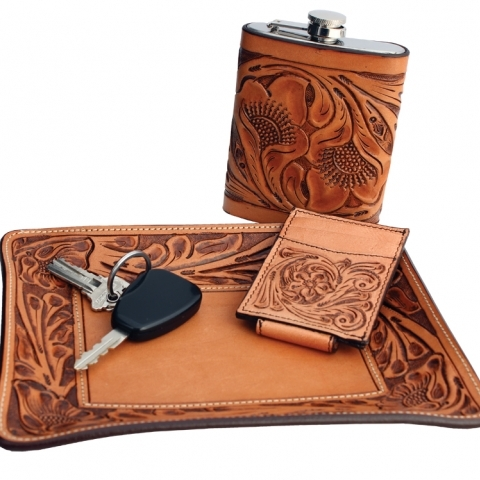 Tooled leather tray and flask
